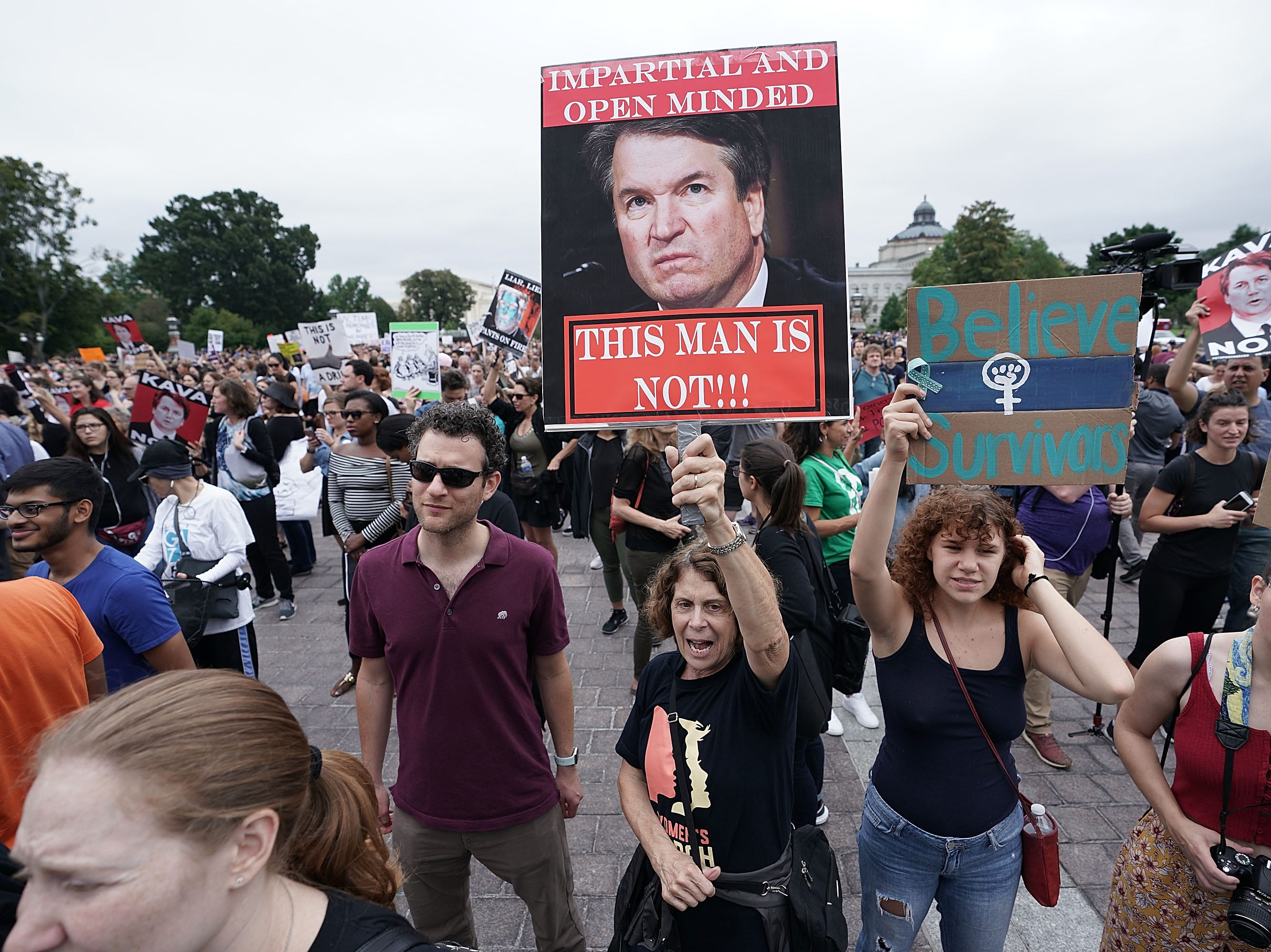 WASHINGTON, DC - OCTOBER 06:  Demonstrators shout slogans during a protest against the nomination of Supreme Court Judge Brett Kavanaugh to the U.S. Supreme Court, at the East front of the U.S. Capitol, October 6, 2018 in Washington, DC. The Senate is expected to pass a vote to confirm the nomination of Judge Brett Kavanaugh to the U.S. Supreme Court today.  (Photo by Alex Wong/Getty Images)