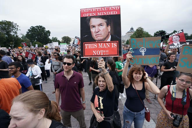 Demonstrators shout slogans during a protest against the nomination of Brett Kavanaugh to the Supreme Court at the east front of the U.S. Capitol on Oct. 6, 2018, in Washington, D.C.