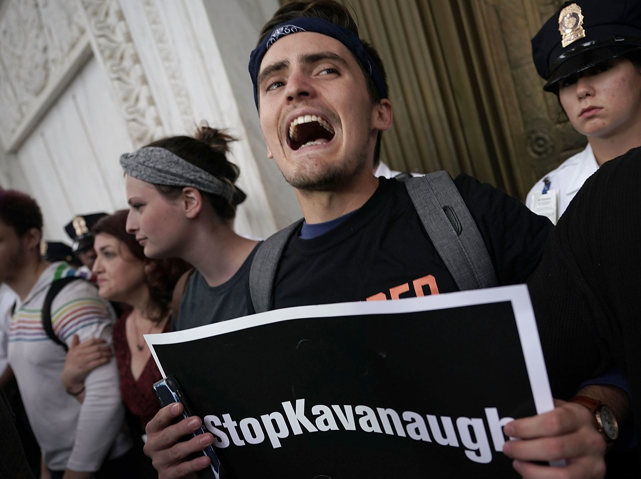 WASHINGTON, DC - OCTOBER 06:  Activists occupy the foyer of the U.S. Supreme Court to protest against the confirmation of Judge Brett Kavanaugh to the Supreme Court October 6, 2018 in Washington, DC. The Senate voted 50-48 to confirm Kavanaugh to replace retired Associate Justice Anthony Kennedy.  (Photo by Alex Wong/Getty Images)