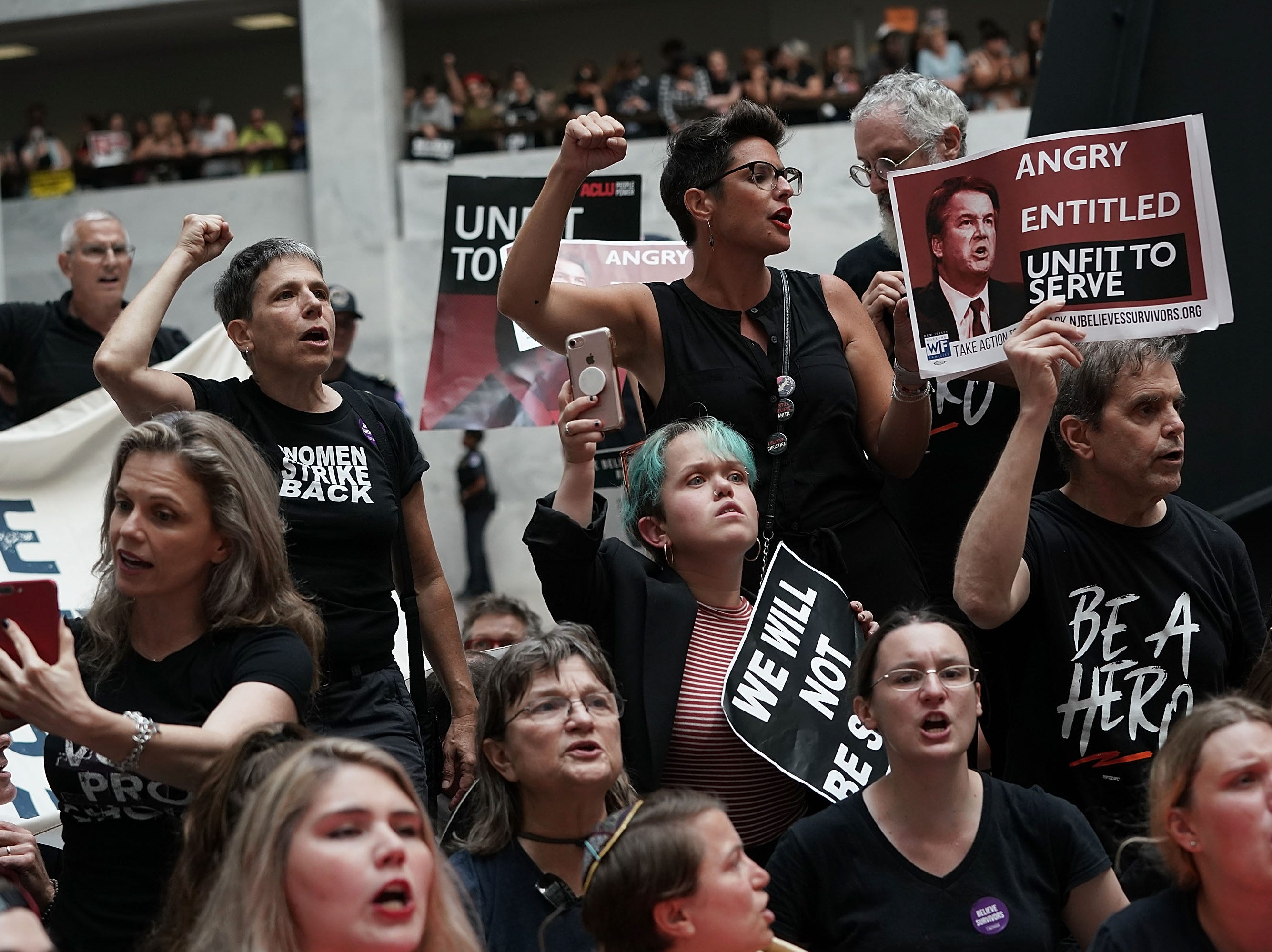 WASHINGTON, DC - OCTOBER 04:  Activists shout slogans during a protest against the confirmation of Supreme Court nominee Judge Brett Kavanaugh October 4, 2018 at the Hart Senate Office Building on Capitol Hill in Washington, DC. Senators had an opportunity to review a new FBI background investigation into accusations of sexual assault against Kavanaugh and Republican leaders are moving to have a vote on his confirmation this weekend. (Photo by Alex Wong/Getty Images)