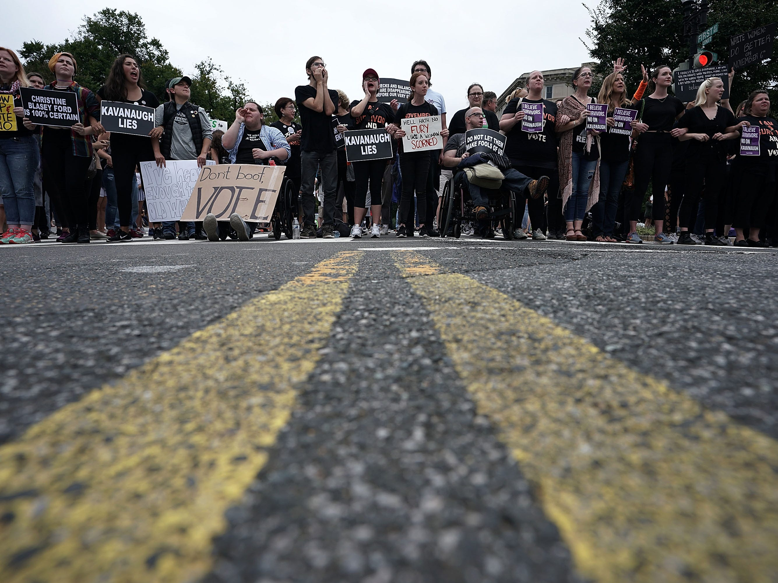WASHINGTON, DC - OCTOBER 06:  Activists block a street in front of the U.S. Supreme Court to protest against the confirmation of Judge Brett Kavanaugh to the Supreme Court October 6, 2018 in Washington, DC. The Senate voted 50-48 to confirm Kavanaugh to replace retired Associate Justice Anthony Kennedy.  (Photo by Alex Wong/Getty Images)