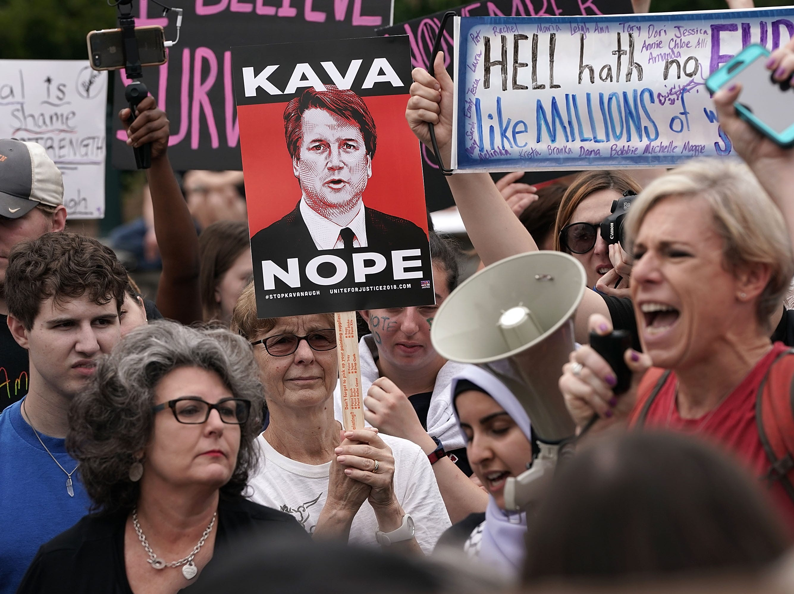 WASHINGTON, DC - OCTOBER 6: Protesters rally against the confirmation of Supreme Court nominee Judge Brett Kavanaugh, outside of the Supreme Court, October 6, 2018 in Washington, DC. The Senate is set to hold a final vote Saturday evening to confirm the nomination of Judge Brett Kavanaugh to the U.S. Supreme Court. (Photo by Alex Wong/Getty Images)