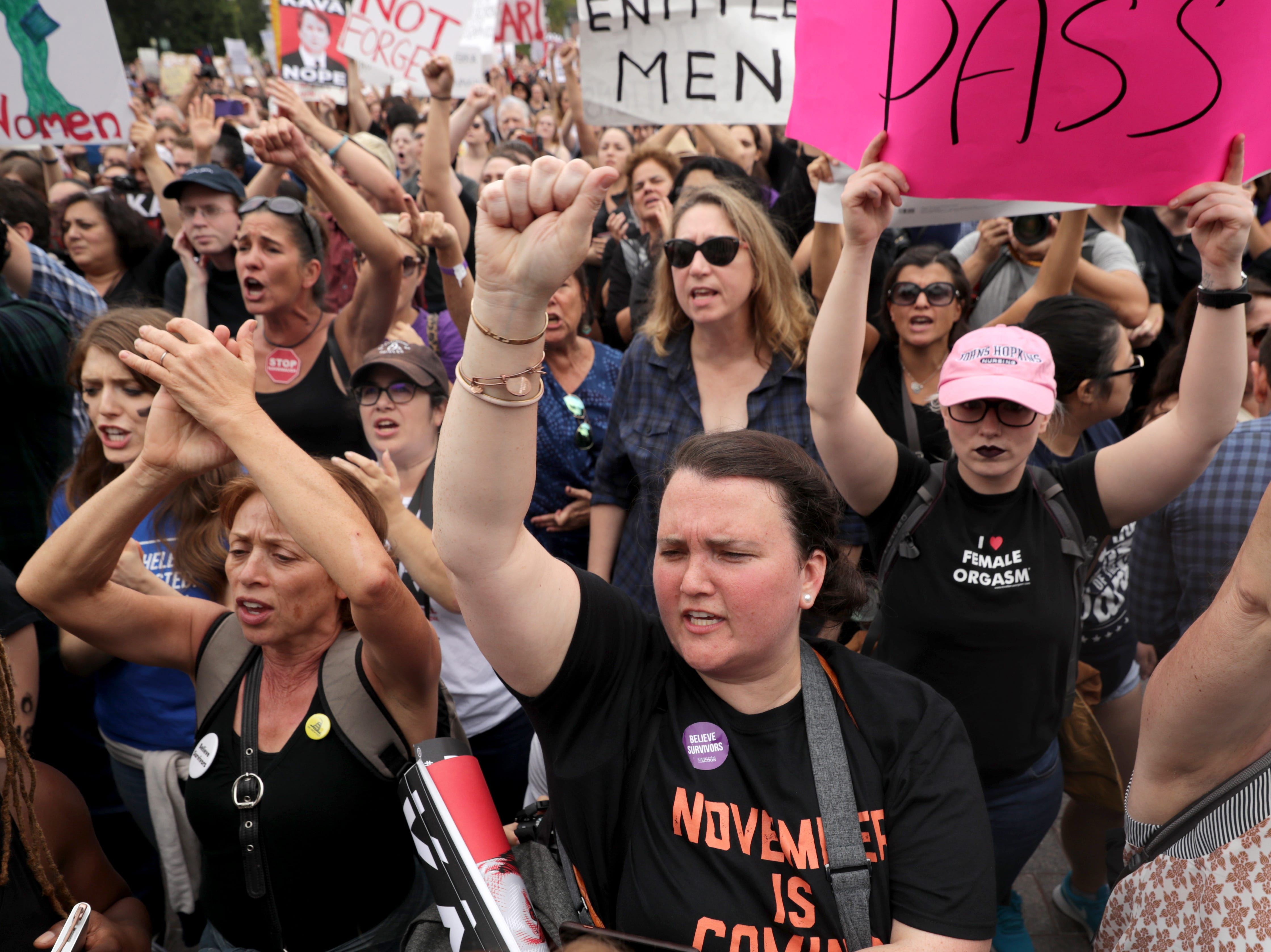 WASHINGTON, DC - OCTOBER 06: People cheer for fellow protesters who occupied the center steps of the East Front of the U.S. Capitol after breaking through barricades to demonstrate against the confirmation of Supreme Court nominee Judge Brett Kavanaugh October 06, 2018 in Washington, DC. The Senate is scheduled to vote on Kavanaugh's confirmation later in the day. (Photo by Chip Somodevilla/Getty Images)