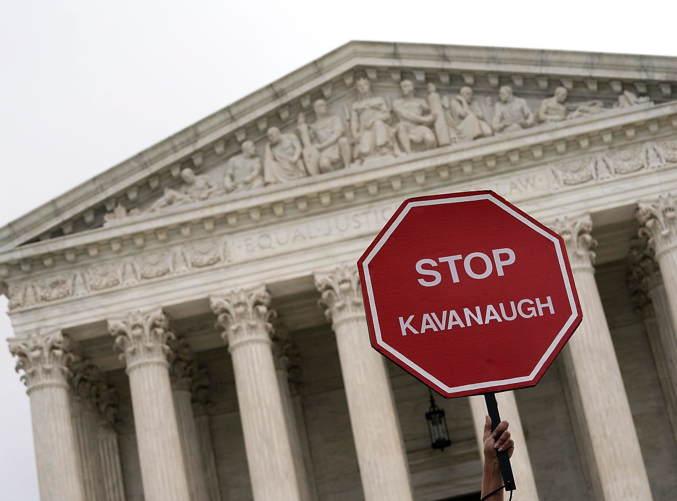"WASHINGTON, DC - OCTOBER 06:  A ""STOP KAVANAUGH"" sign is seen during a protest against the confirmation of Supreme Court nominee Judge Brett Kavanaugh, outside of the Supreme Court, October 6, 2018 in Washington, DC. The Senate is set to hold a final vote Saturday evening to confirm the nomination of Judge Brett Kavanaugh to the U.S. Supreme Court. (Photo by Alex Wong/Getty Images)"