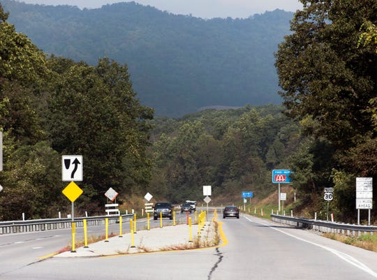 Traffic moves along U.S. 30 east near the top of the mountain in Fulton County on Monday, October 8, 2018. A high-friction surface was completed in the area to improve road conditions.