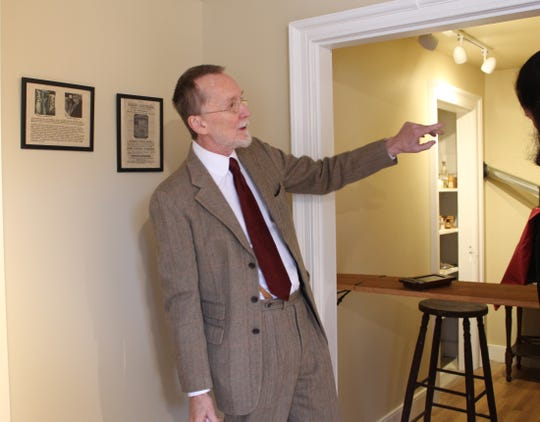 Grant Romer, a photography historian and museum director, shows off the replication studio on the opening day.