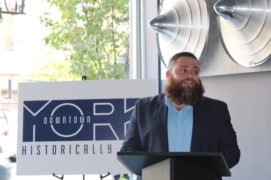 """Silas Chamberlin, CEO of Downtown Inc, explains the """"historically edgy"""" rebrand concept for York City at a launch event on Monday, Oct. 8."""