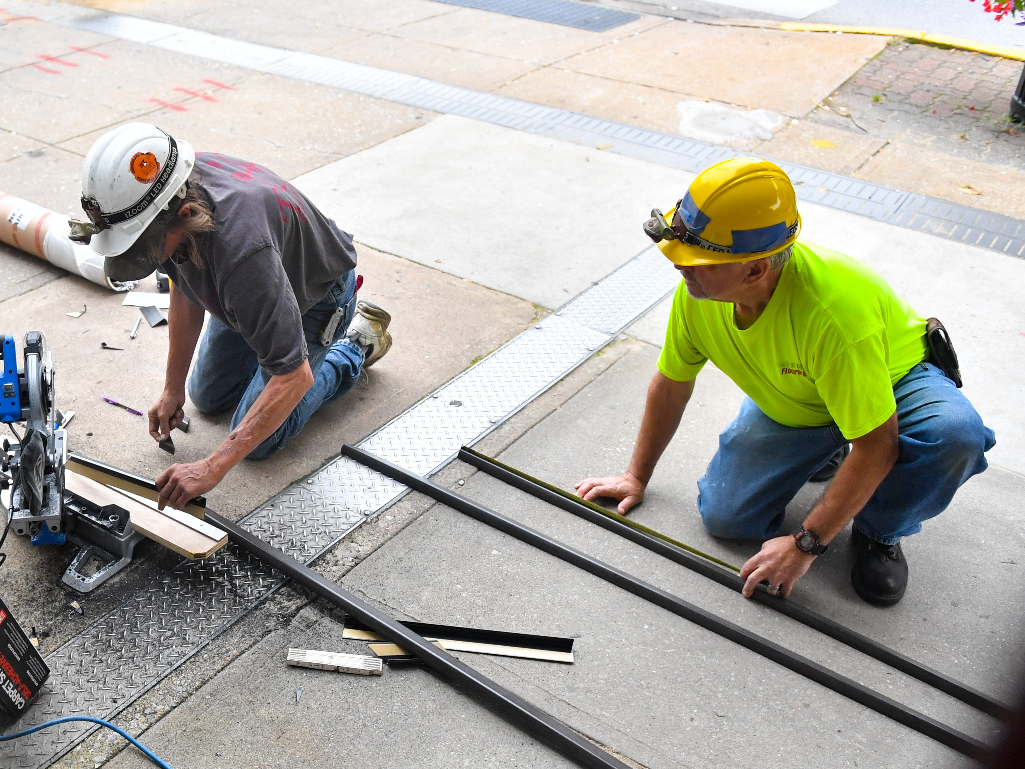 Construction workers outside cut materials use around the York Capital Theatre, October 5, 2018. The theatre is located at 50 N. George St. in downtown York.