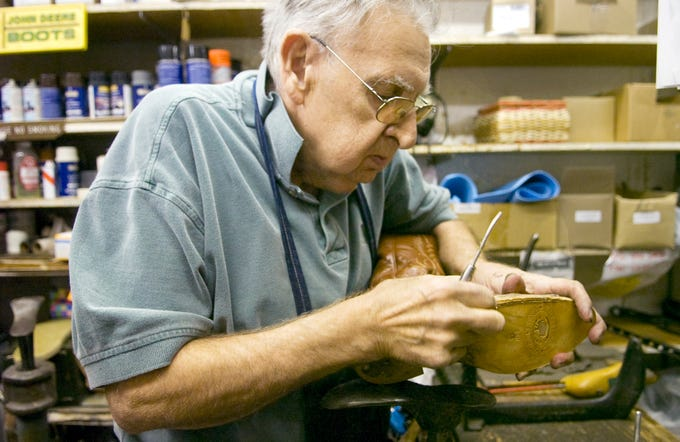 George Vicchiotti works to repair a boot at Reineberg's Shoes in Springettsbury Township in October 2008. Business was brisk, but more so because of competition closing than the economy, the owner said at the time.