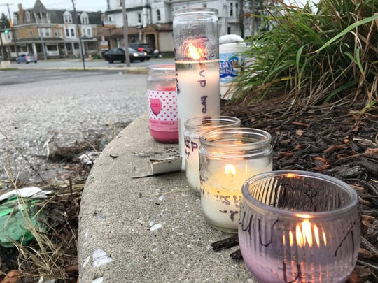 Lit candles in the 100 block of South Richland Avenue, York, mark the spot where Tyler Owens, 24, was fatally wounded.