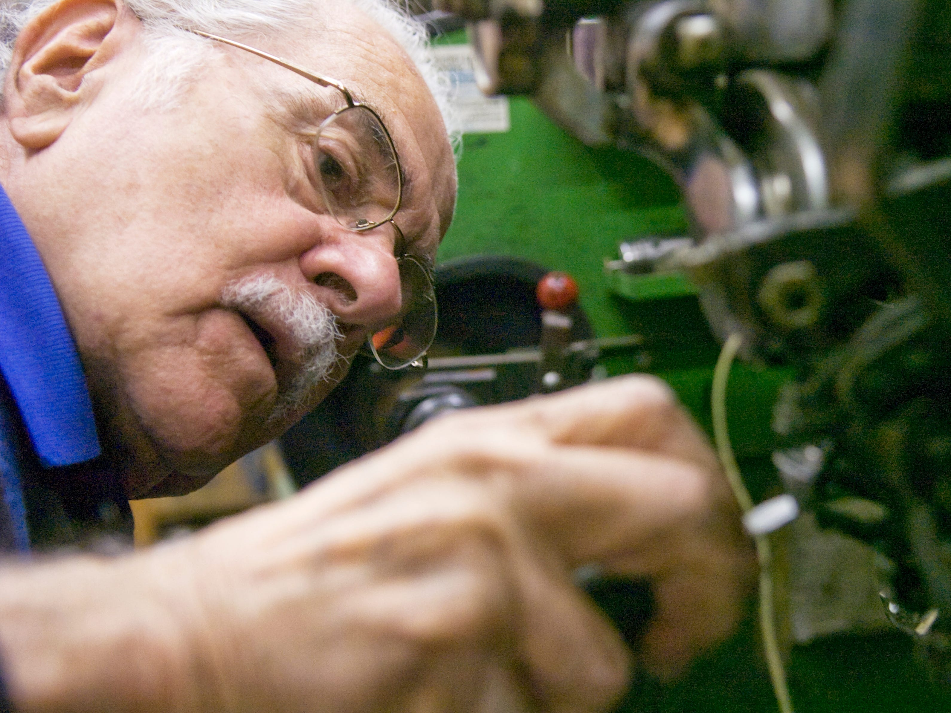Bud Butera works with the machine that stitches together the shoe and sole at Reineberg's Shoes in Springettsbury Township in October 2008. Butera said he started working in shoe repair when he was 14 years old. Butera still works at the shop one day a week..