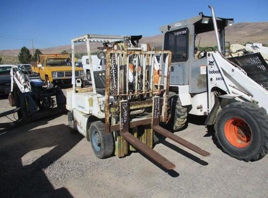 A Mitsubishi FD25 forklift is for sale Saturday, Oct. 13, 2018 at the Nevada government surplus sale at the Tahoe-Reno Industrial Center east of Sparks.