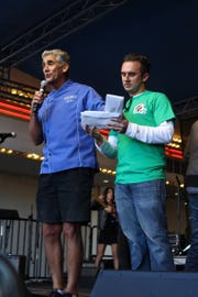 Gregg Carano of the Eldorado Resort Casino, left, and his son, Donald Carano II, present awards in the sauce cooker contest  at the 2018 Eldorado Great Italian Festival in downtown Reno.