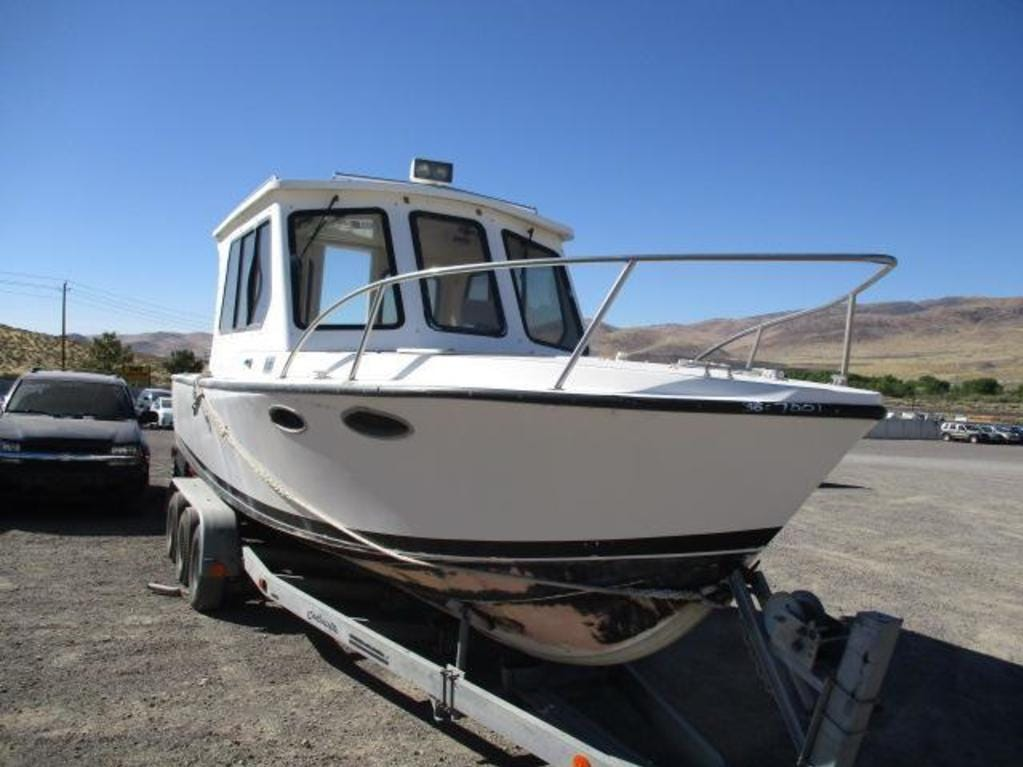 A 1993 Offshore 28-foot boat is for sale Saturday, Oct. 13, 2018 at the Nevada government surplus sale at the Tahoe-Reno Industrial Center east of Sparks.