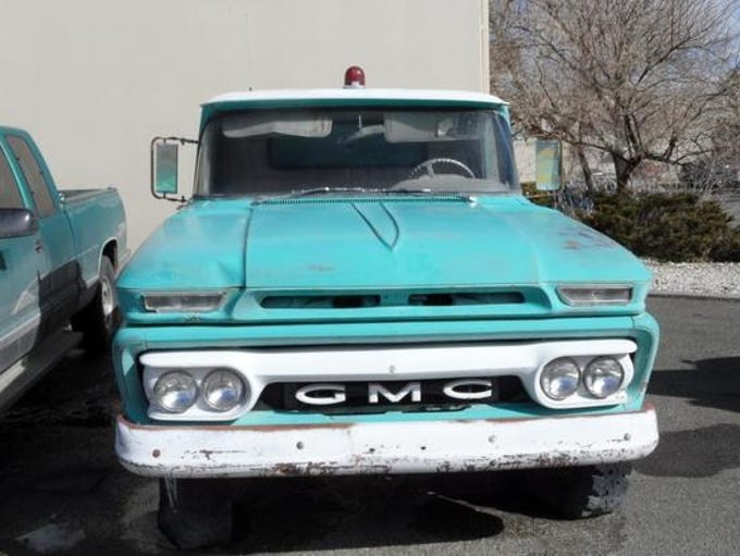 A 1962 GMC K150 pickup is for sale Saturday, Oct. 13, 2018 at the Nevada government surplus sale at the Tahoe-Reno Industrial Center east of Sparks.
