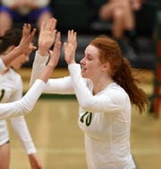 Bishop Manogue's Emma Pence celebrates a point aganist Spanish Springs at Manogue High School on Sept. 18, 2018. Manogue defeated the Spanish Spring 3-0.