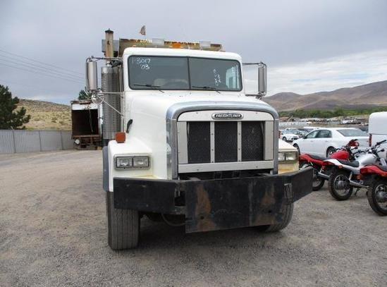 A 2003 Freightliner 10-wheel dump druck is for sale Saturday, Oct. 13, 2018 at the Nevada government surplus sale at the Tahoe-Reno Industrial Center east of Sparks.