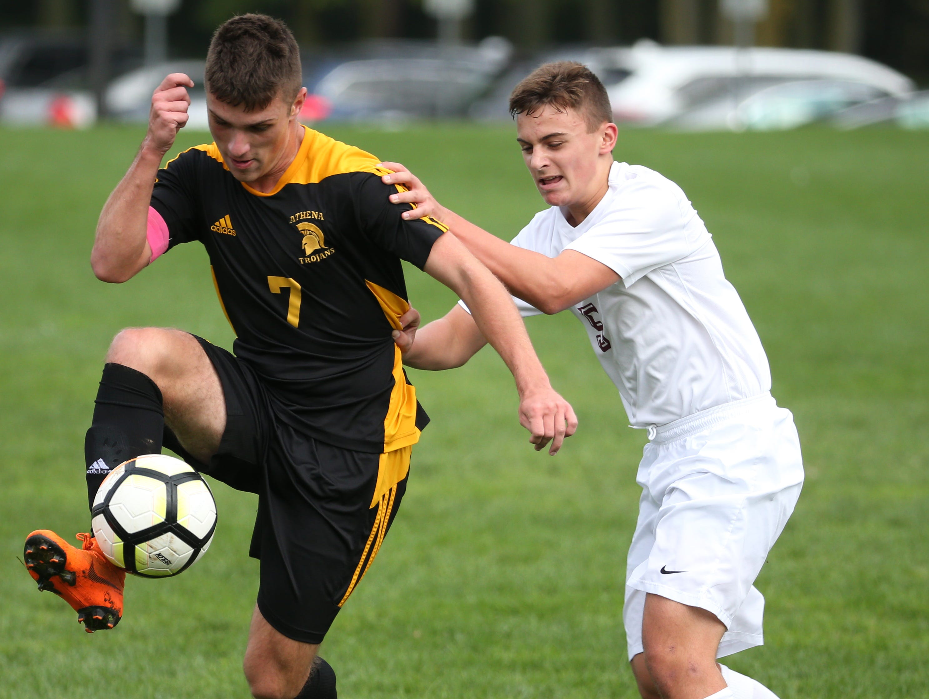 Greece Athena #7 Charles Takatch  against Aquinas #5 Ben Geyer.