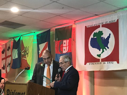 Retired Surrogate Court Judge Edmund Calvaruso honored by Italian Civic League president Quintino DiCesare with lifetime achievement award