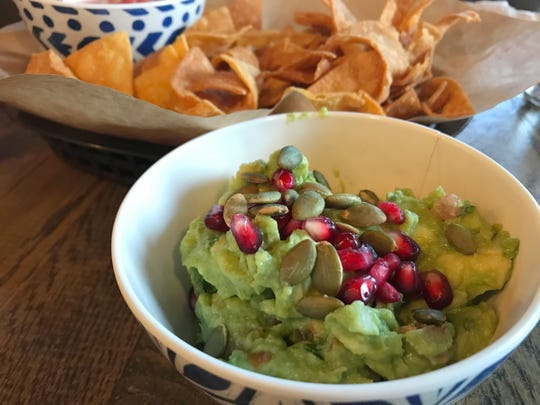 The guacamole at Lulu was garnished with pepitas and pomegranate arils.