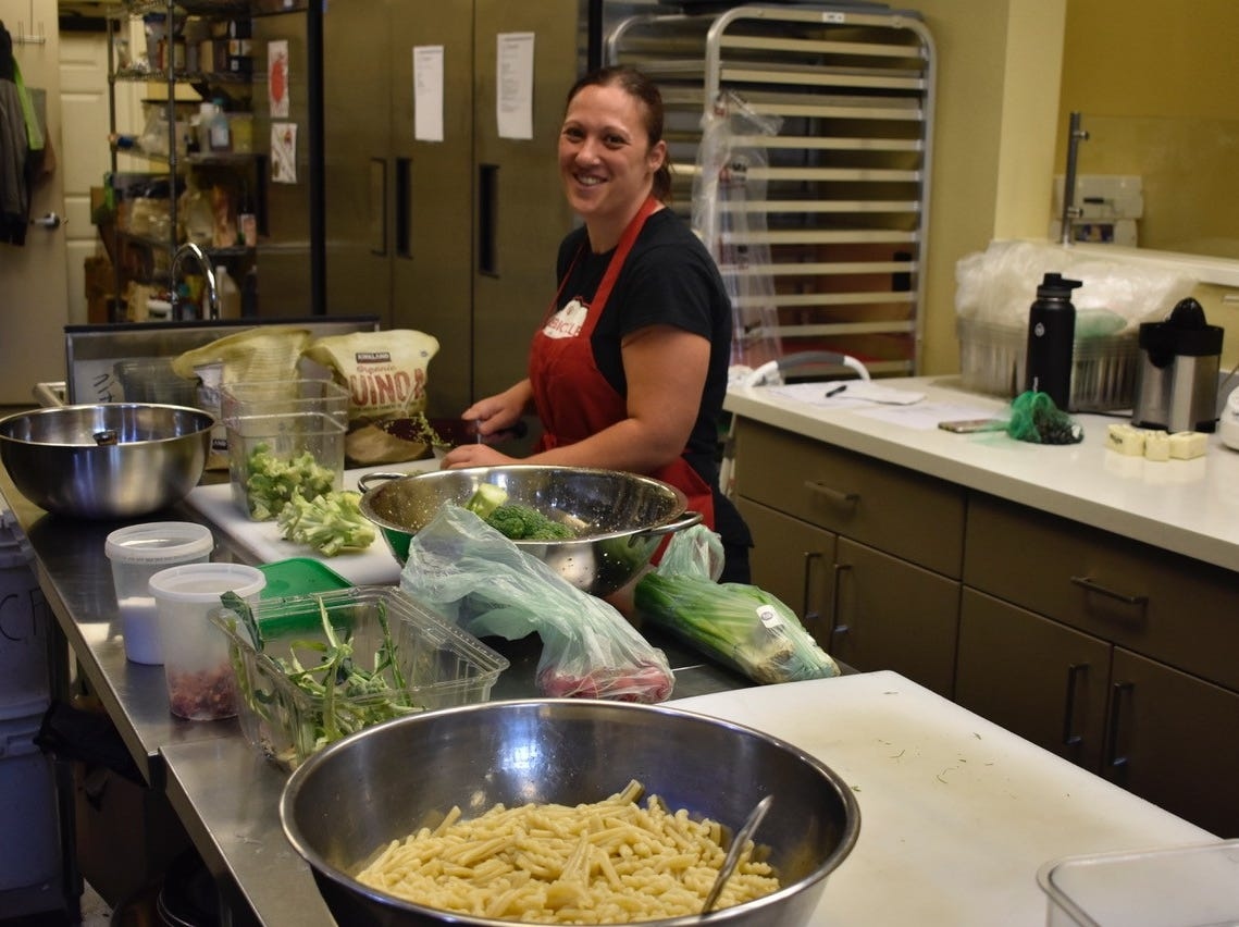 Joanna Self works on a pasta dish at Red Bicycle Catering in Redding