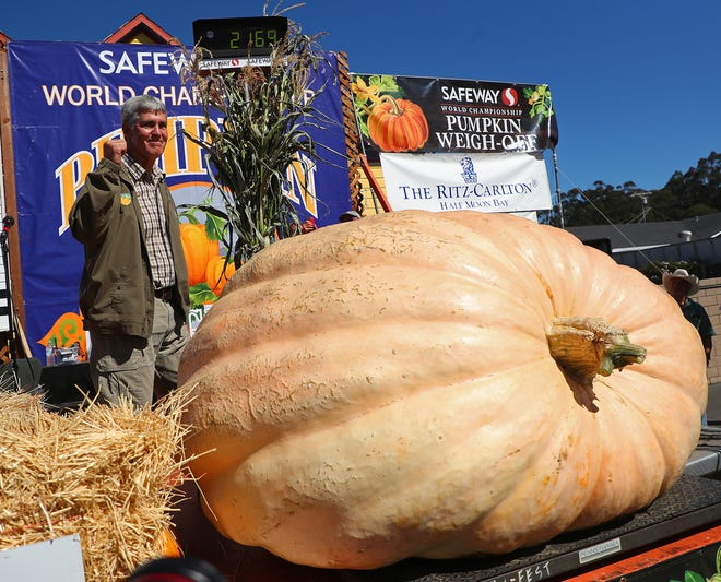 Steve Daletas of Pleasant Hill, Ore., celebrates his first place win in the 45th annual Safeway World Championship Pumpkin Weigh-Off on Monday, Oct. 8, 2018, in Half Moon Bay, Calif.