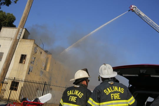 Firefighters battle a structure fire at 38 Soledad St. in Salinas' Chinatown Sunday.