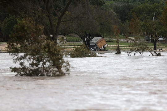 An RV park in Junction, Texas, was swept away before dawn Monday, Oct. 8, 2018 after heavy rainfall caused flooding of the South Llano River.