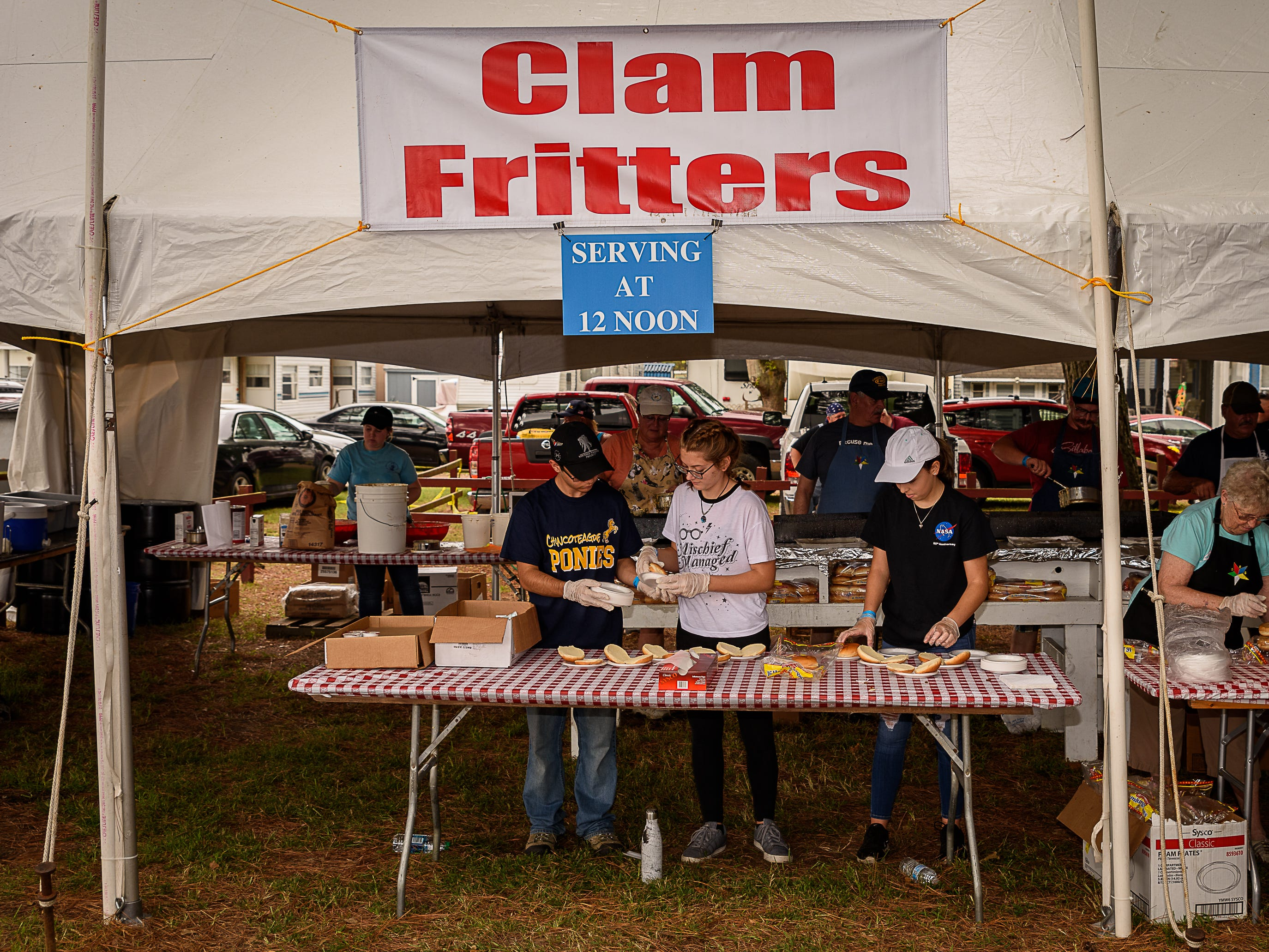 Young volunteers man the front line at the Clam Fritter booth at Chincoteague Oyster Festival on Oct. 6.