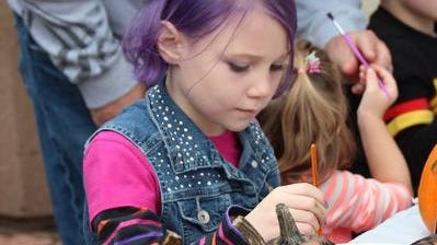 Children can enjoy pumpkin painting at the festival.