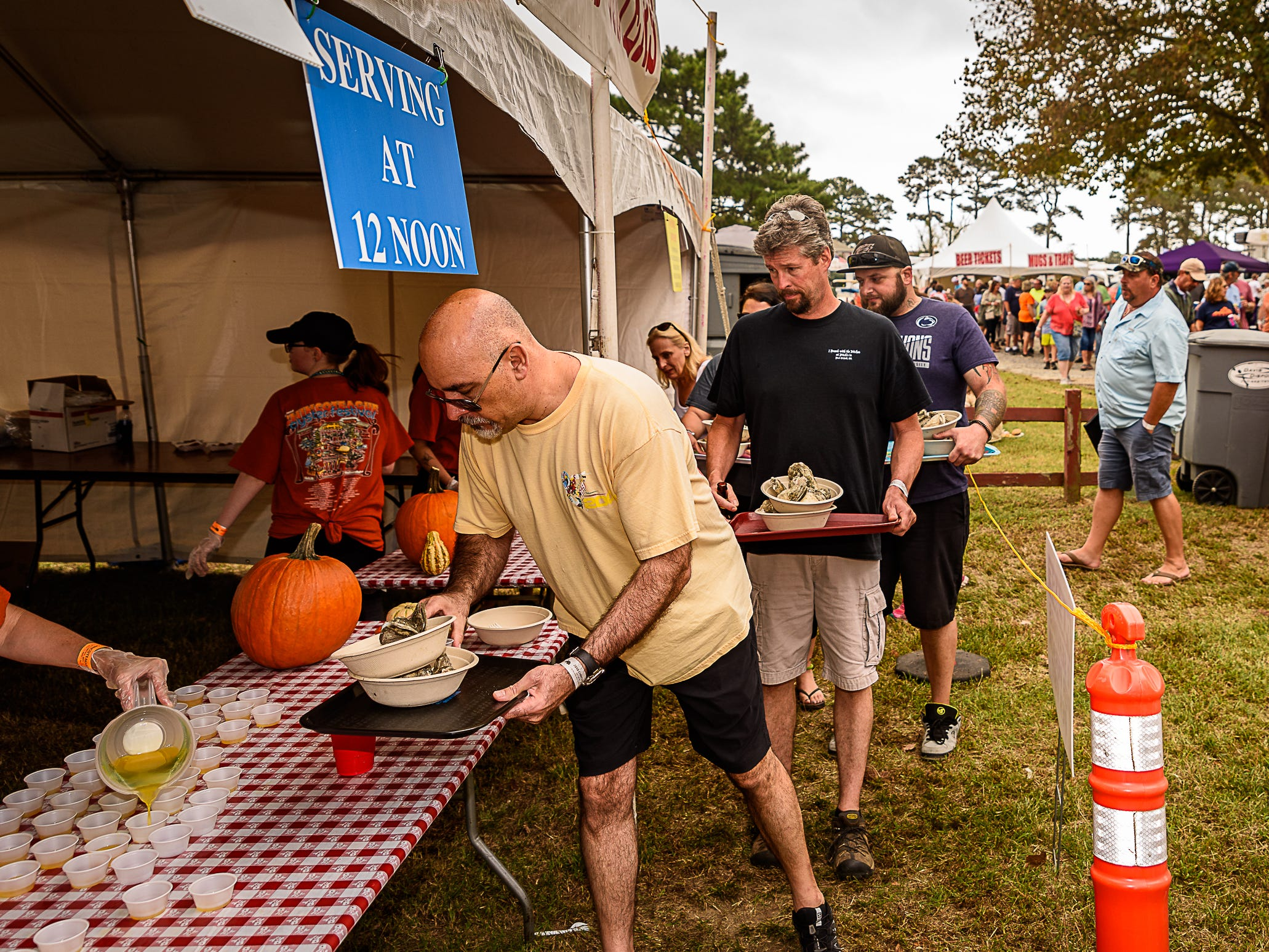 Festival-goers pick up steamed oysters at the event in Chincoteague.