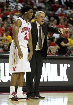 February 23, 2011; College Park, MD, USA;  Maryland Terrapins head coach Gary Williams directs guard Pe'Shon Howard (21) during the game against the Florida State Seminoles at the Comcast Center. Maryland beat Florida State 78-62. Mandatory Credit: Mitch Stringer-USA TODAY Sports