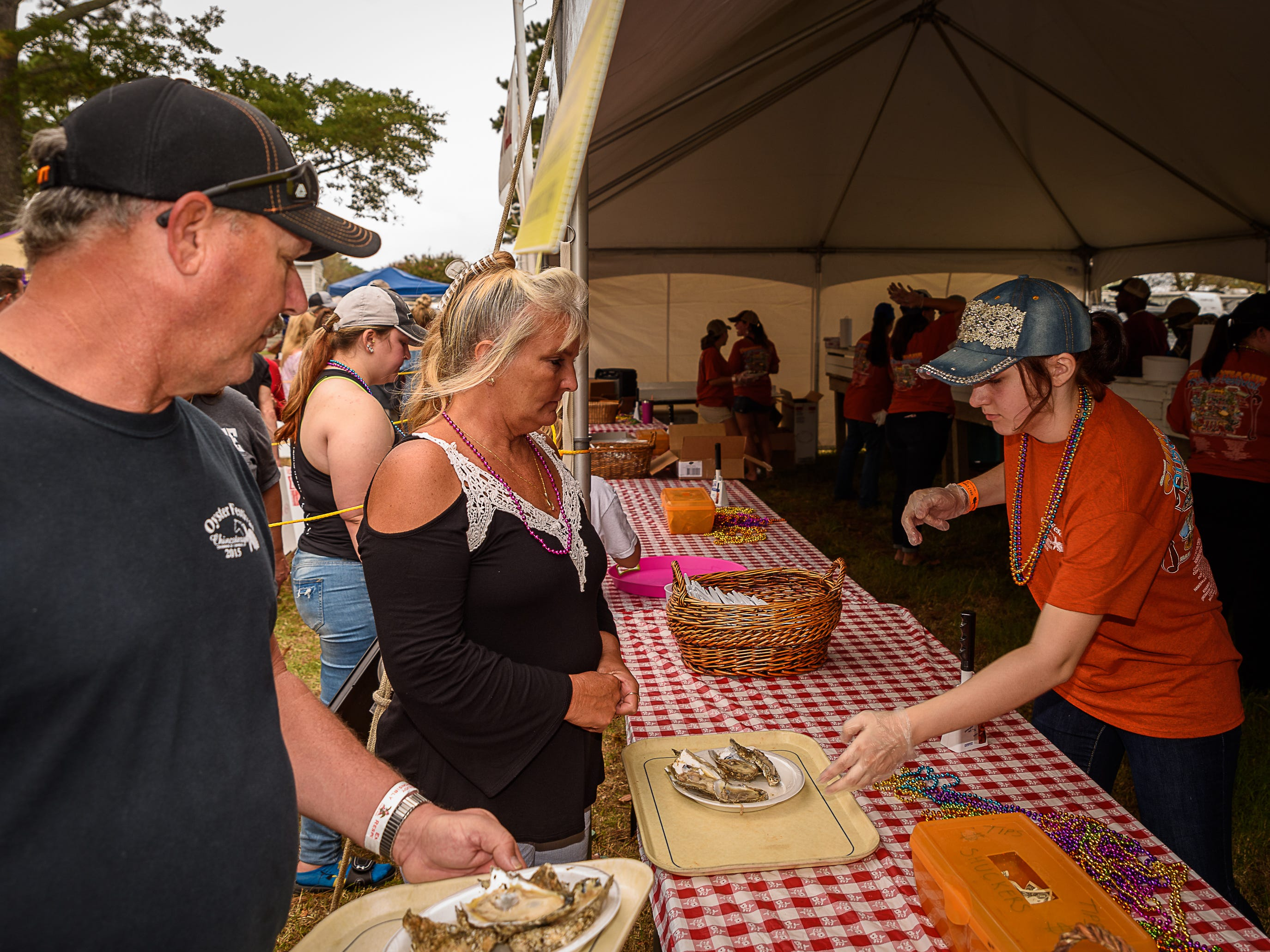 A volunteer hands out a plate of oysters at the Chincoteague Oyster Festival.