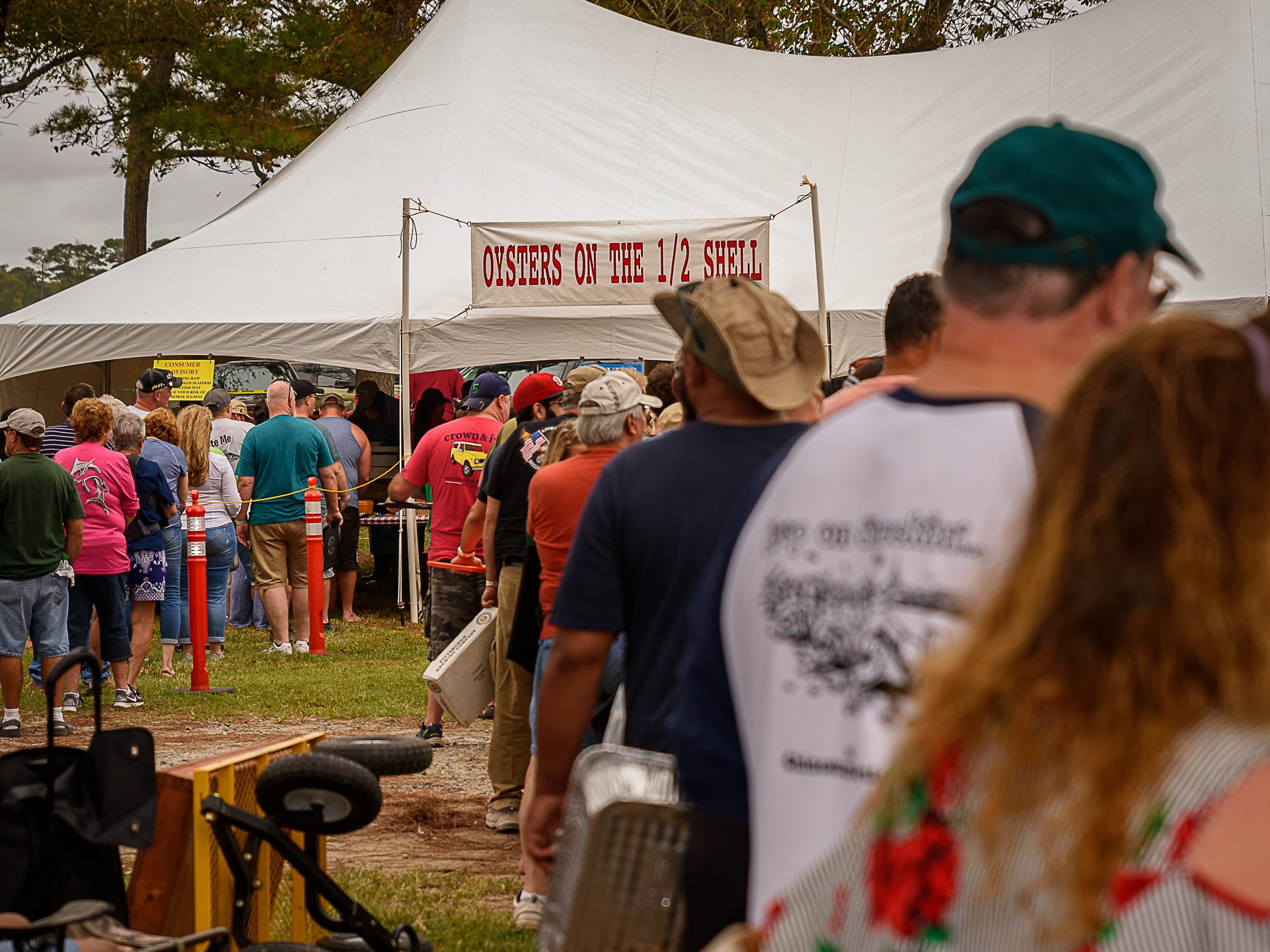 Hungry patrons line up at an oyster booth at  the Chincoteague Oyster Festival.
