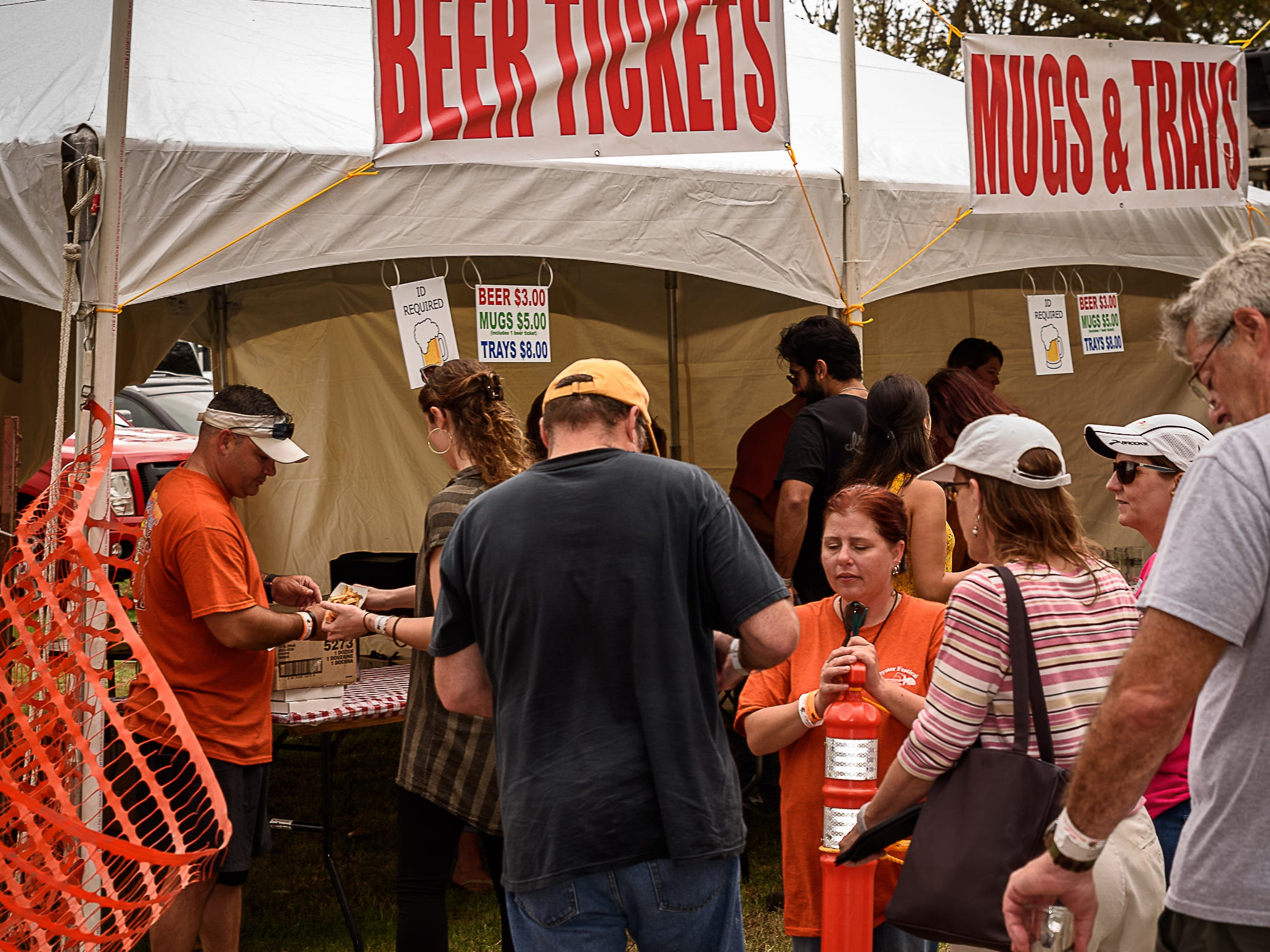 Volunteers check identities of people in the  line for beer tickets at Chincoteague Oyster Festival.