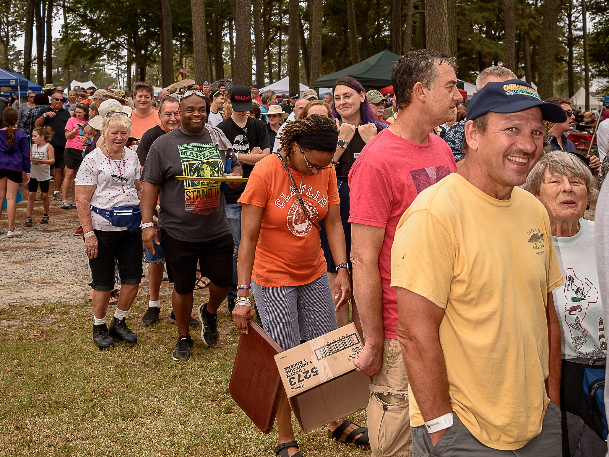 Festival-goers wait in the line for freshly shucked oysters at the Chincoteague festival.