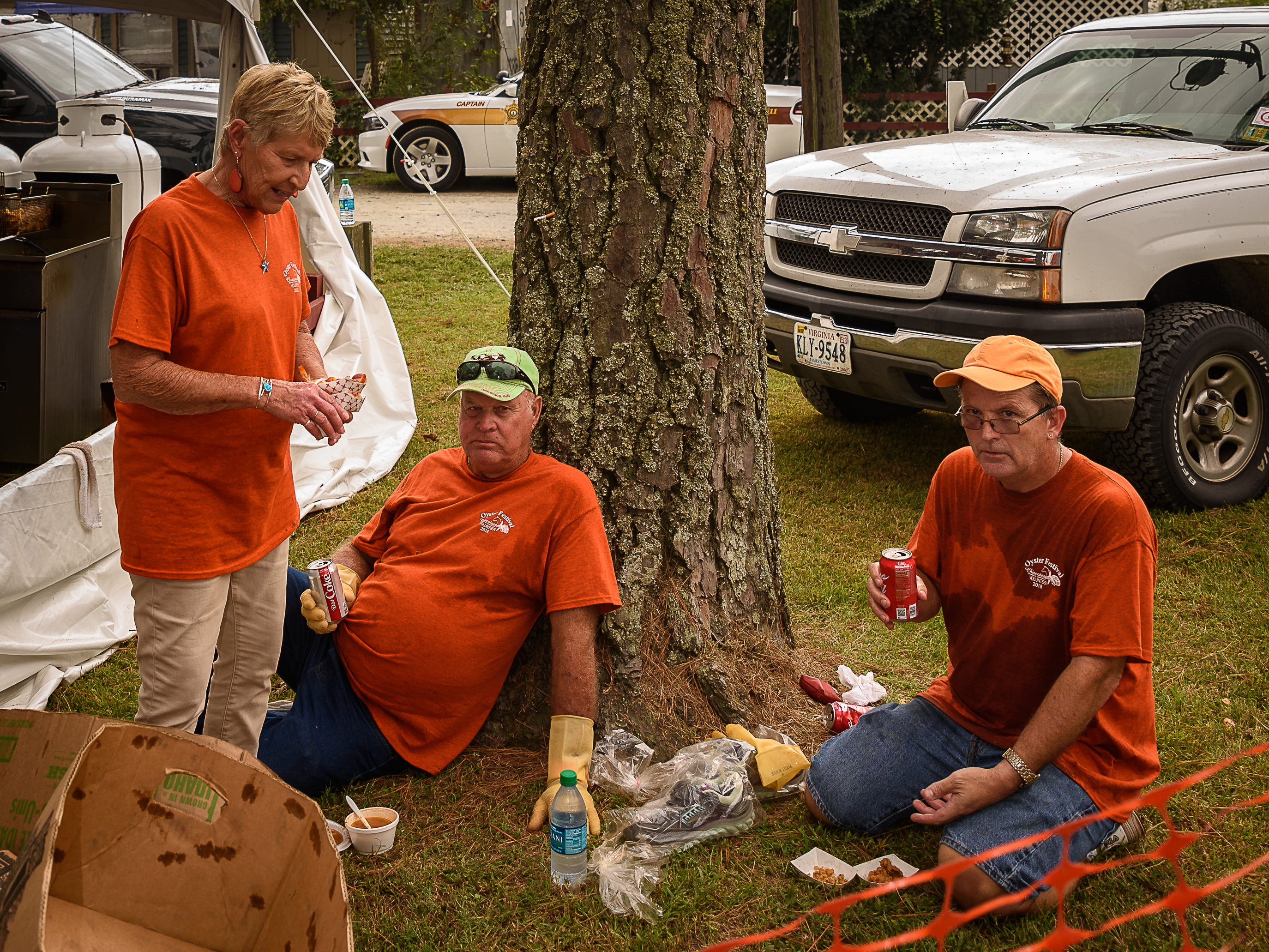 Volunteers take a break to enjoy some of the fare offered at the oyster festival.