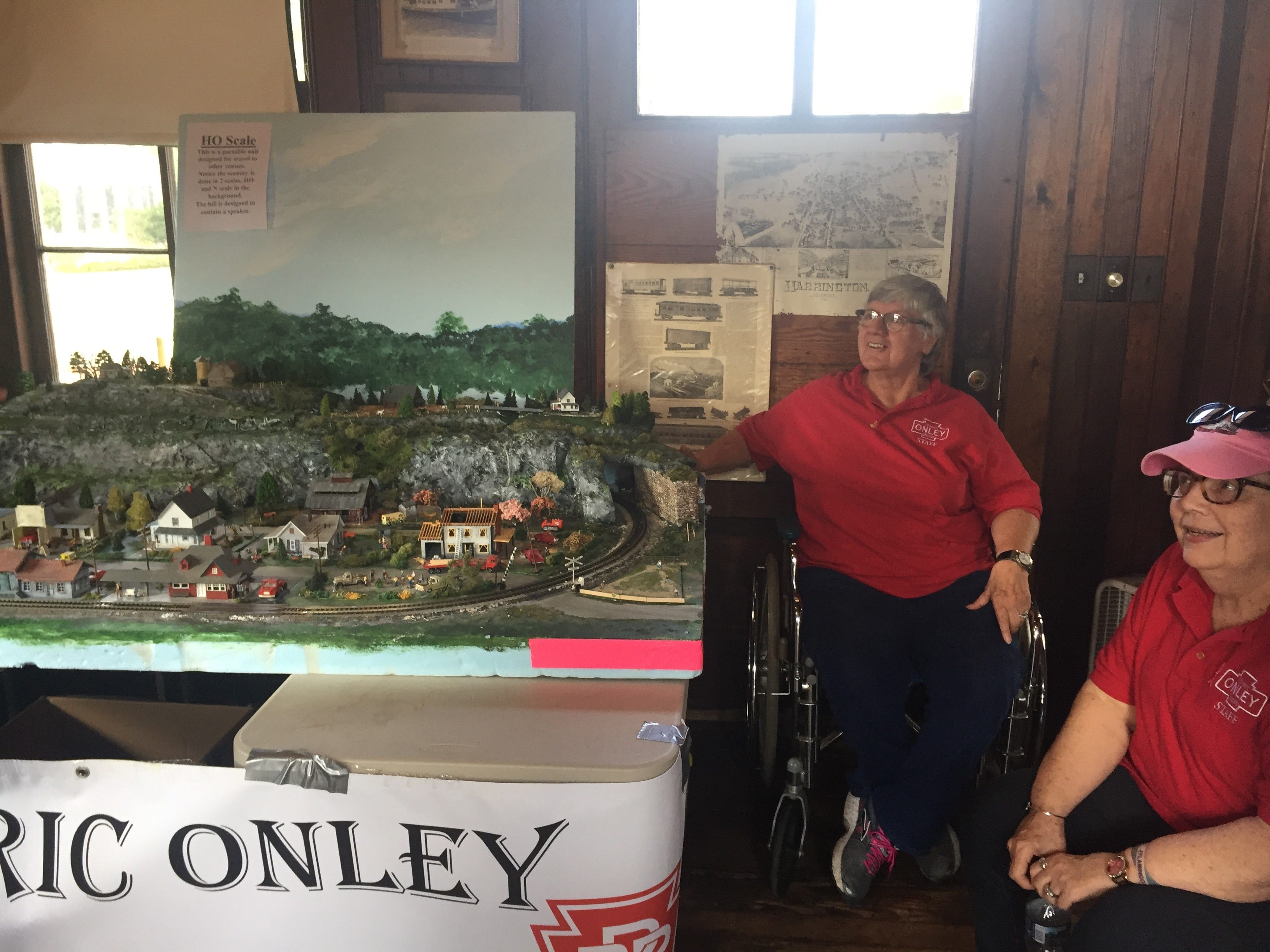 Jan Siglin and Billye D. Custis of Onley, VIrginia volunteer at a model railroad display by the Historic Onley Train Station during the Golden Spike Railroad Festival in Parksley, Virginia on Saturday, Oct. 6, 2018.