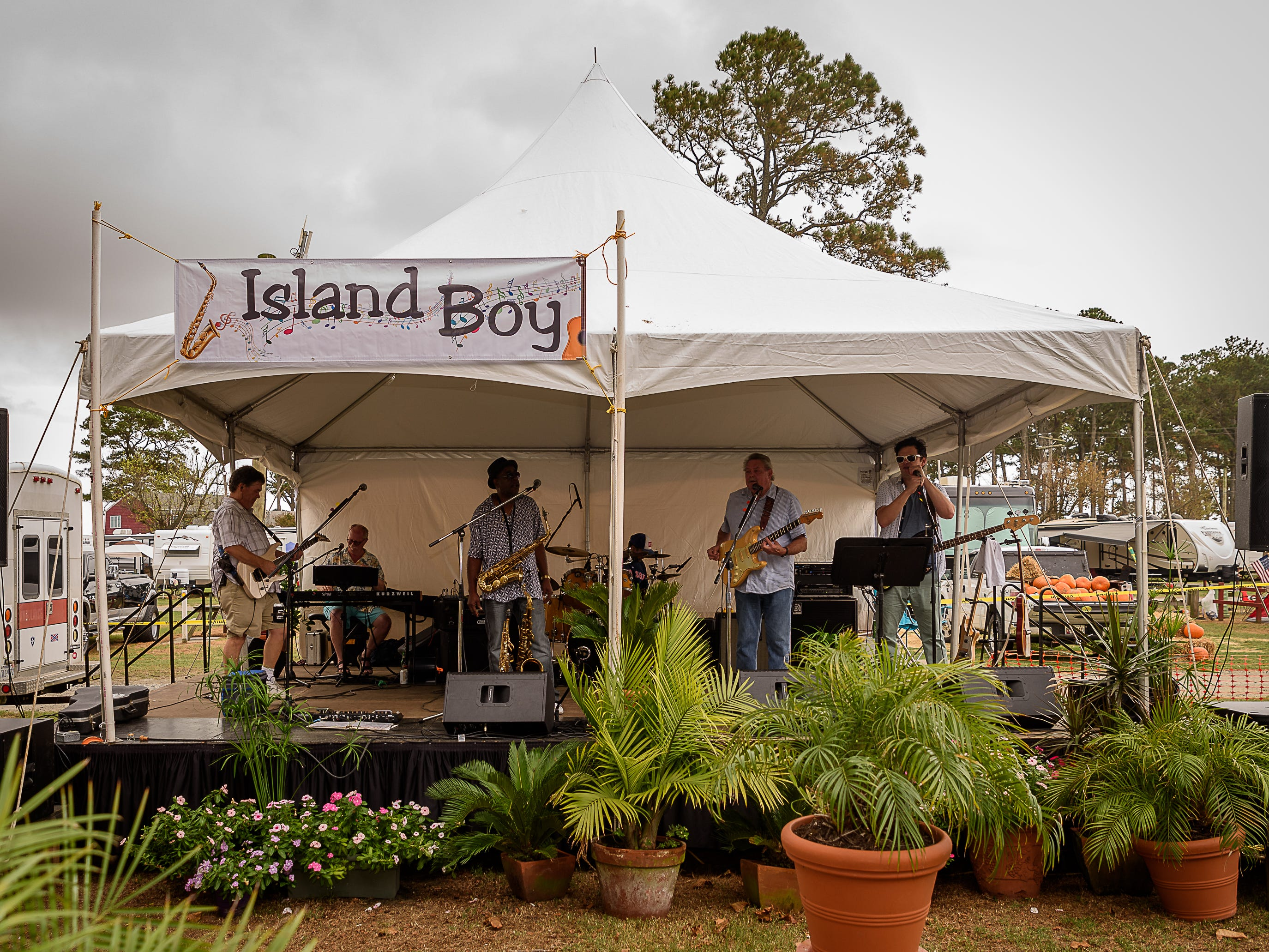 The  Island Boy band entertains the crowd at the Chincoteague Oyster Festival held Saturday, Oct. 6, at Tom's Cove Campground. The annual festival served up Chincoteague oysters and other seafood along with music and fun.