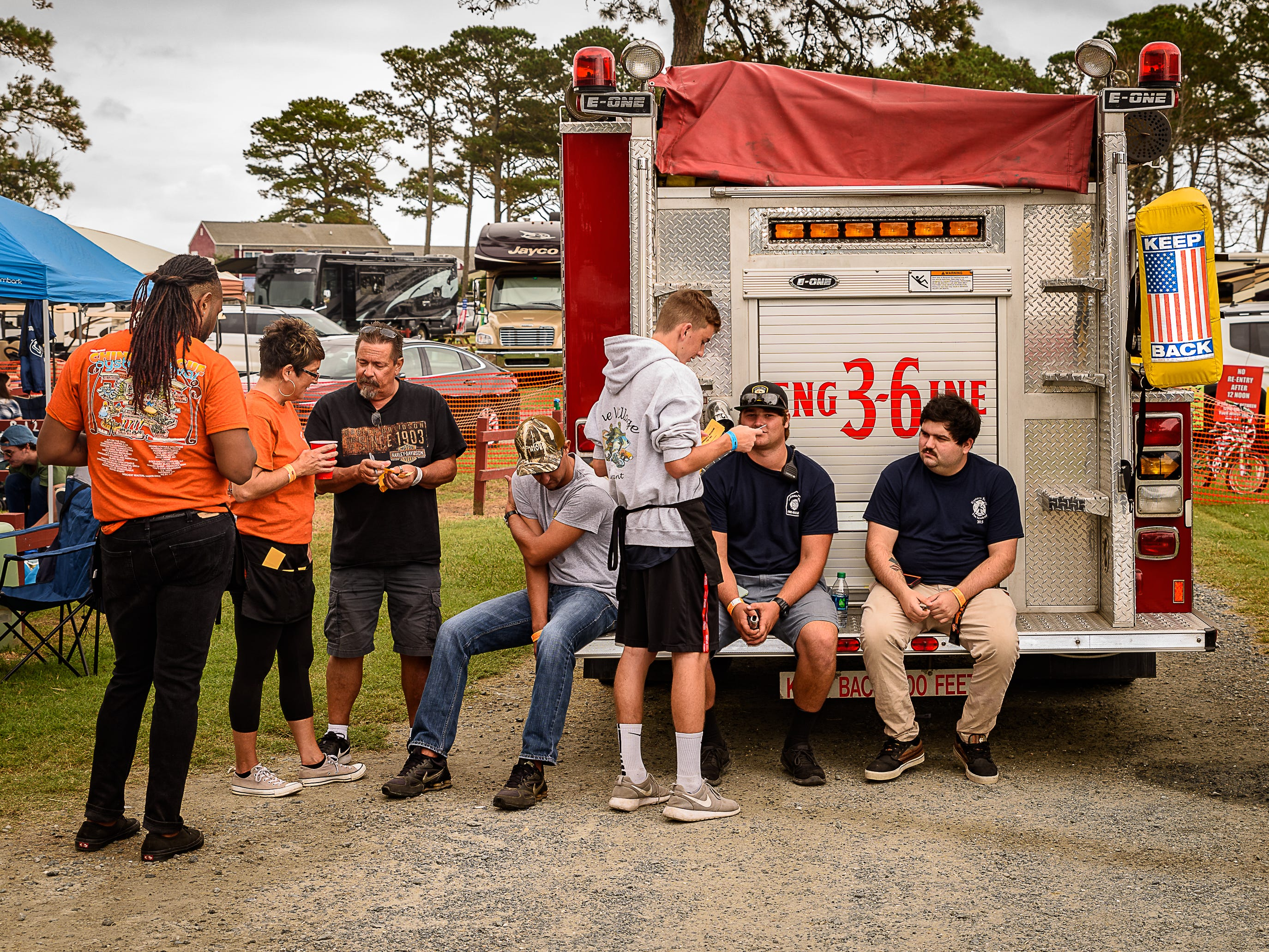 Festival volunteers take a moment to chat with members of the Chincoteague Volunteer Fire Company.