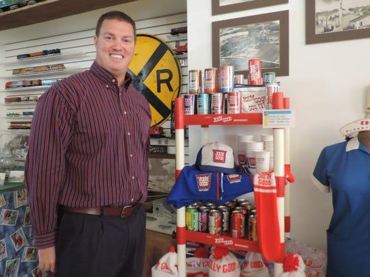 John Rassel, president of Krier Foods which produces Jolly Good Soda, inside the Random Lake Area Historical Society museum.