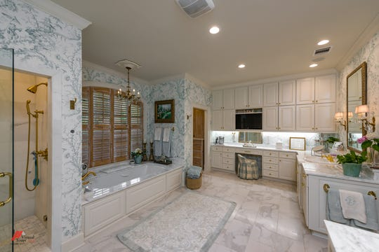 The master bath features an oversized steam shower and heated flooring.