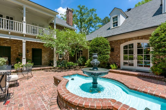 A New Orleans style courtyard features a fountain.