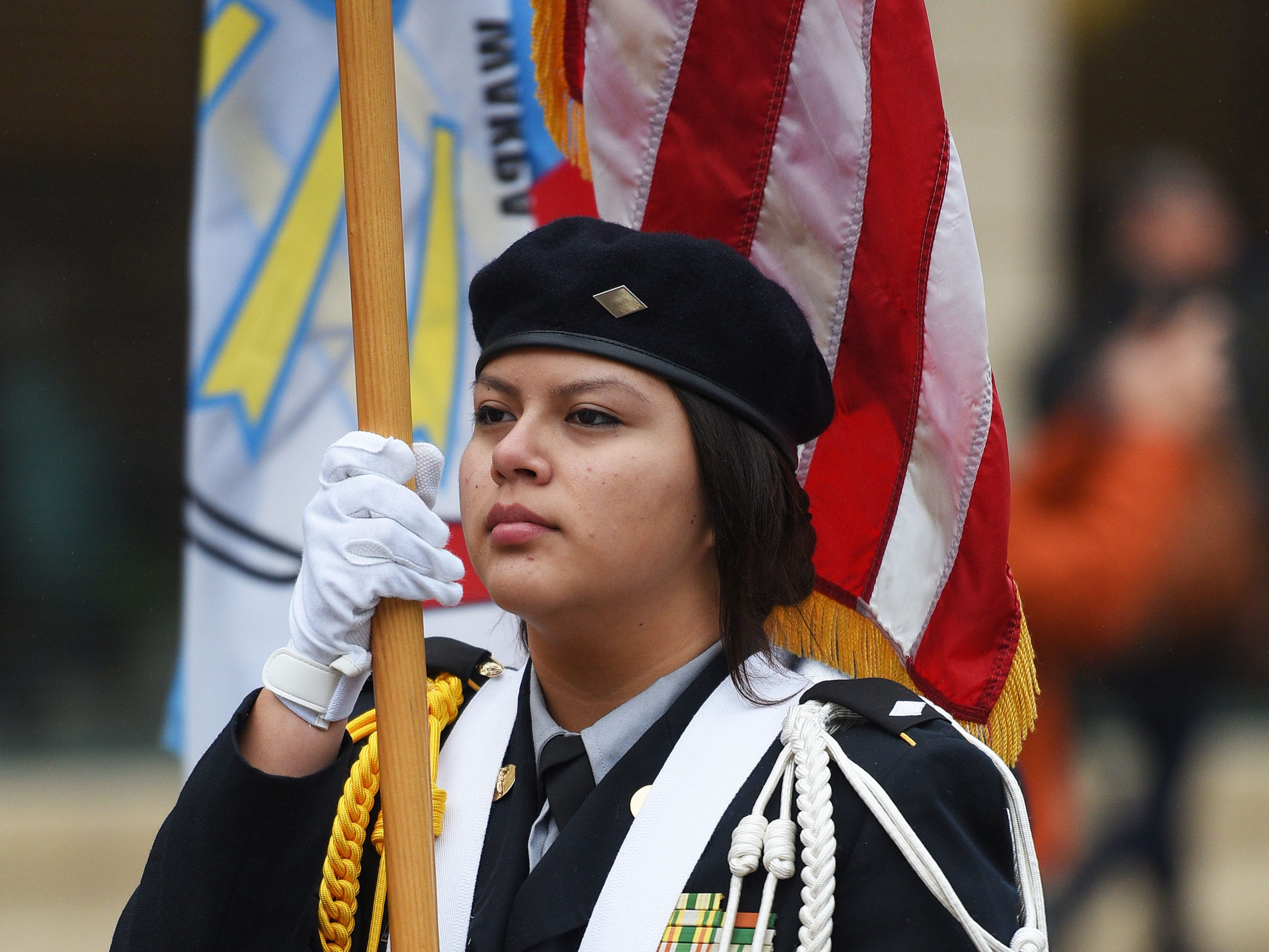"Flandreau JROTC member Bianca Ten Fingers marches in the Native Americans' Day parade Monday, Oct. 8, in downtown Sioux Falls. The theme this year was ""Honoring Our Elders."""