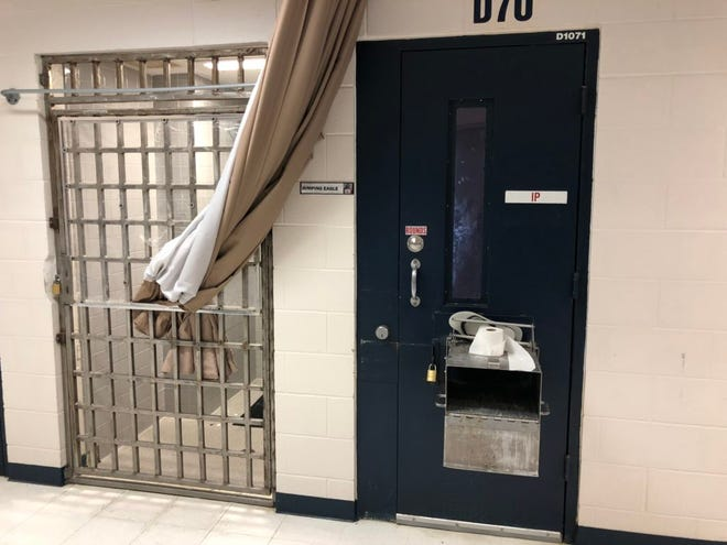 In the high-risk segregation unit at the South Dakota Women's Prison, inmates are kept alone in single cells, shown at right. They use a shower that is encircled by a curtain, allowing basic privacy, but not as much as in lower-security units.