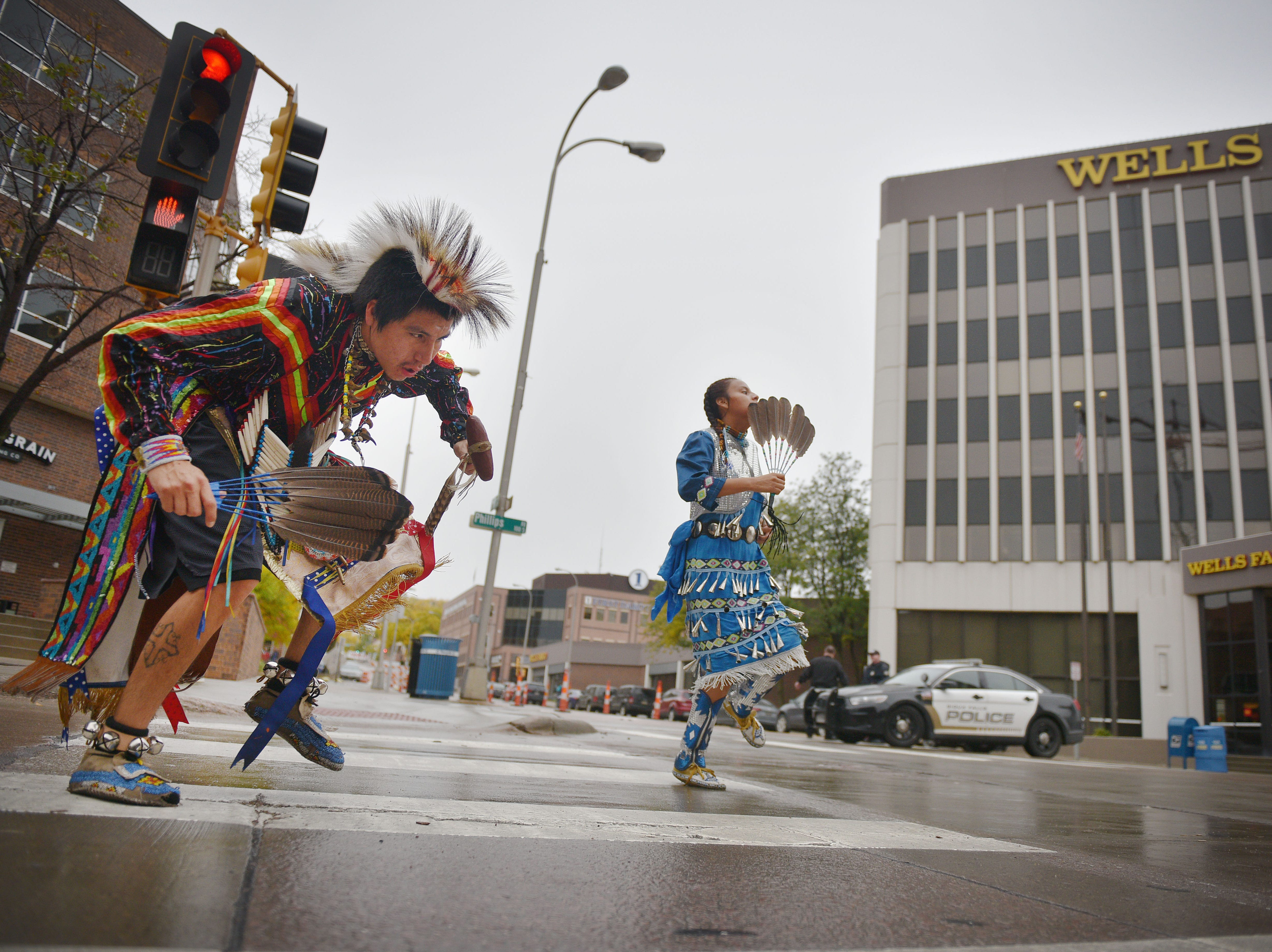 "Thomas Billie and Dreicca Long Crow, Rosebud Sioux Tribe, dance in the Native Americans' Day parade Monday, Oct. 8, in downtown Sioux Falls. The theme this year was ""Honoring Our Elders."""