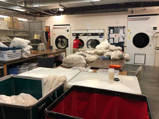 The laundry room is a busy place in the South Dakota Women's Prison in Pierre, where inmates earn 25 cents per hour to clean and dry clothing and linens for the prison and other government agencies.