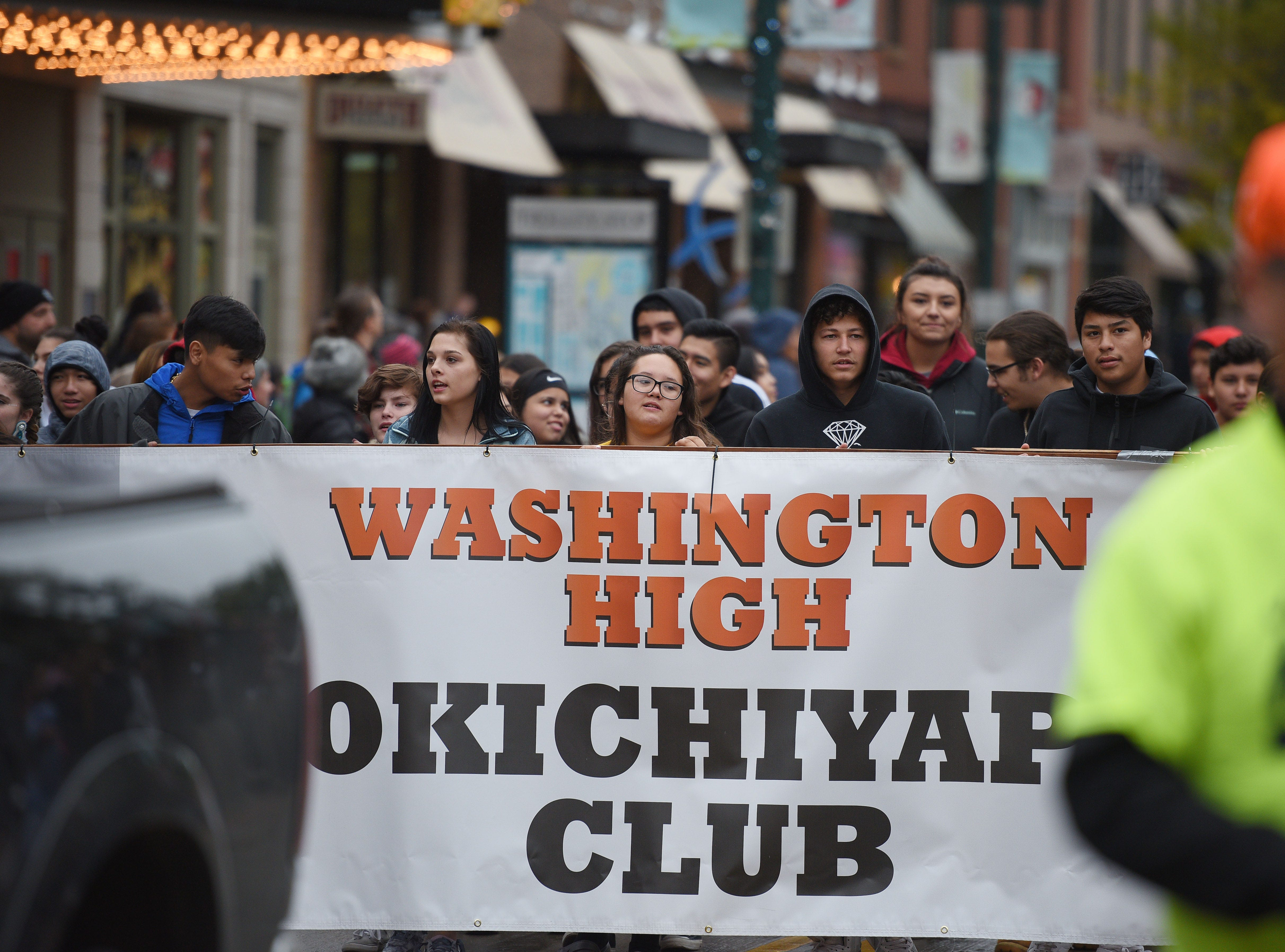 "Washington High School Okichiyapi Club participates in the Native Americans' Day parade Monday, Oct. 8, in downtown Sioux Falls. The theme this year was ""Honoring Our Elders."""