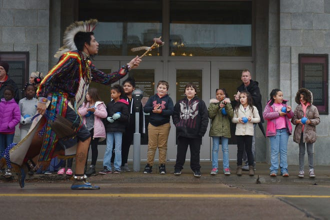 "Children watch Thomas Billie, Rosebud Sioux Tribe, dance in the Native Americans' Day parade Monday, Oct. 8, in downtown Sioux Falls. The theme this year was ""Honoring Our Elders."""