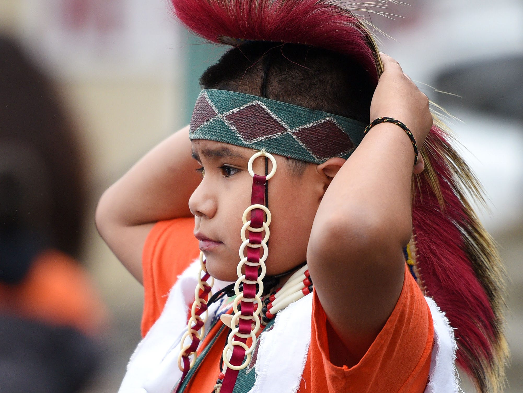 """Josiah Foolbull gets ready for the Native Americans' Day parade Monday, Oct. 8, in downtown Sioux Falls. The theme this year was """"Honoring Our Elders."""""""